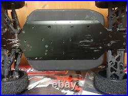 Used broke a arm Team Corally 1/8 Python V2 With 2 3S LIPO BATTERIES INCLUDED